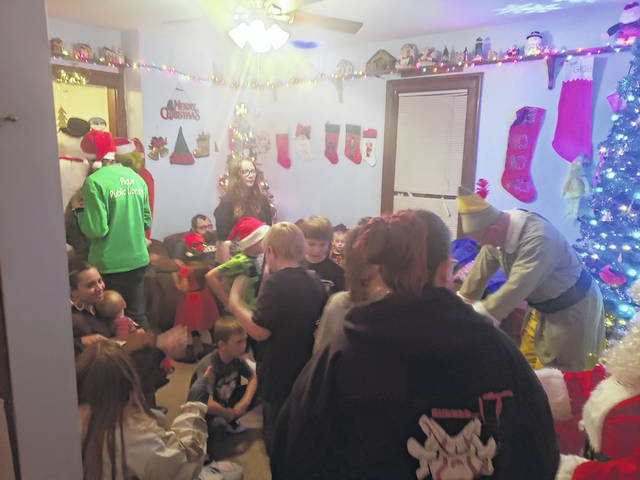 Provided photo Adams Street residents in Piqua held their annual block Christmas Party this month. The Adam's family amped-up the party this year with a new addition to their third annual Christmas Party for kids in the neighborhood. This year, they had Mr. and Mrs. Clause, the Elf, and the Grinch, along with Frosty. The total was 37 kids and their parents. They plan on adding another or two character to the mix next year. They also plan on the party being even bigger.