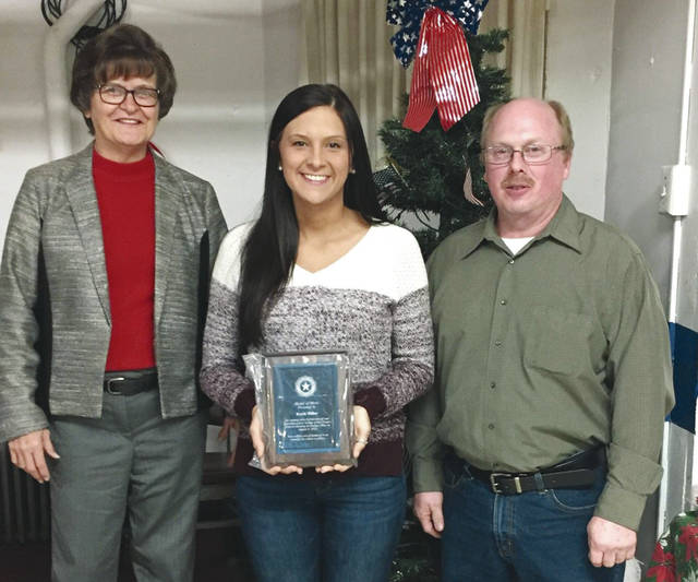 Provided photo The Piqua post of the American Legion Auxiliary recently honored Piqua High School graduate Kayla Miller for her heroism in helping shooting victims during the Oregon District shootings in Dayton on Aug. 4, 2019. Keitha Meyers, left, commander and Gary Felver, adjutant, right, awarded Miller, center, with the Medal of Merit for providing aid to victims during the tragedy. Miller is a Bowling Green State University graduate and nurse at Upper Valley Medical Center.