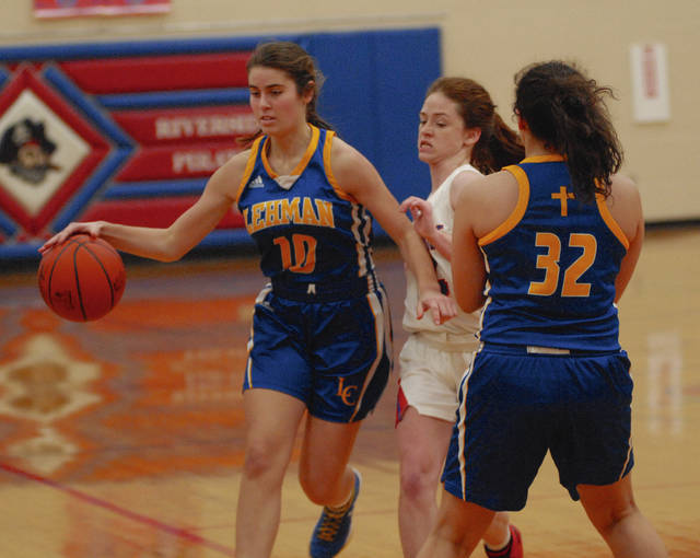 Rob Kiser|Miami Valley Today Lehman Catholic's Anna Cianciolo uses a screen set by Lauren McFarland Thursday night.