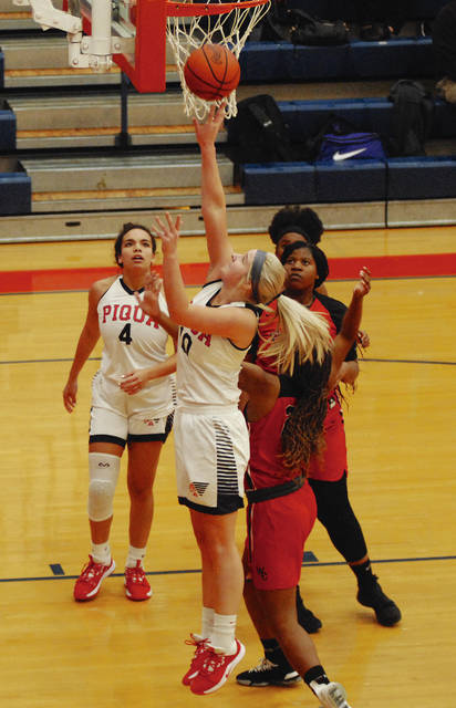 Rob Kiser|Miami Valley Today Piqua's Aubree Schrubb goes up for two points as Tylah Yeomans looks on.