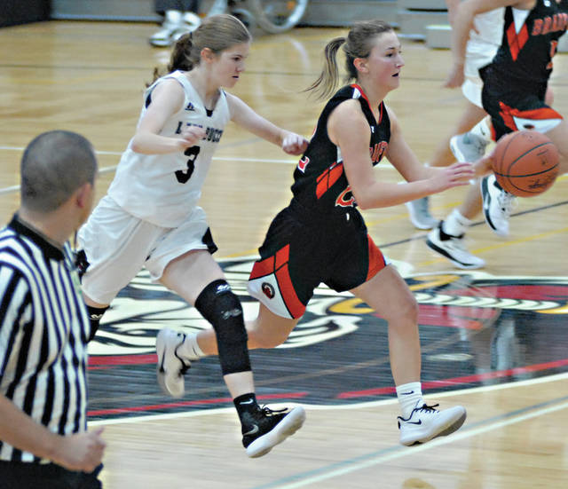 Rob Kiser|Miami Valley Today Bradford's Rylie Canan pushes the ball down the floor as Covington's Ellie Hedges gives chase.