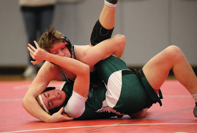 Lee Woolery | Miami Valley Today Covington's Kellan Anderson sticks a pin during the Troy Invitational Saturday at the Trojan Activities Center.