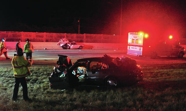 Troopers from the Piqua post of the Ohio State Highway Patrol investigate a two-vehicle crash on southbound I-75 near State Route 41 on Sunday evening.