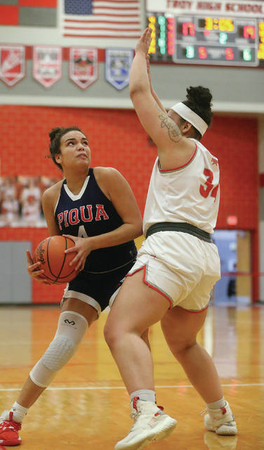 Lee Woolery | Miami Valley Today Piqua's Tylah Yeomans looks for a shot as Troy's Tia Bass defends Wednesday at the Trojan Activities Center.
