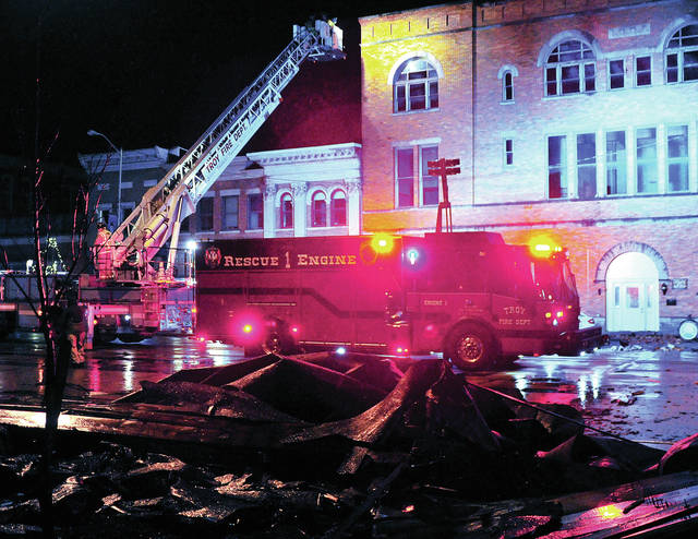 Troy Fire Department Tower 1 is used to check downtown rooftops for damage following a tornado that caused significant damage in Troy on Saturday evening.