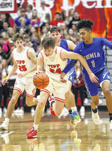 Lee Woolery | Miami Valley Today Tippecanoe's Ben Knostman (24) brings the ball up the floor after a steal as teammate Gavin Garlitz (25) trails the play Friday against Xenia at Tippecanoe High School.