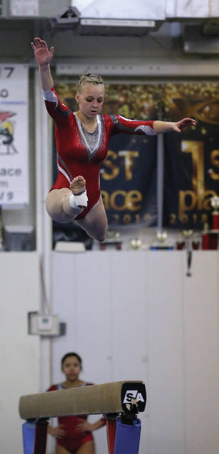 Lee Woolery | Miami Valley Today Troy's Sarah Kraynek competes on the balance beam during the Northmont Invitational Monday at Gem City Gymnastics.