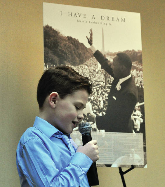 "Josh Richard, a student at Piqua Catholic School, sings ""God Bless America"" during the Martin Luther King Jr. Celebration at the Piqua YWCA on Monday afternoon."