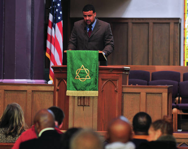 Lincoln Community Center Executive Director Shane Carter speaks during Monday's Martin Luther King Jr. community celebration at the First United Methodist Church in Troy.