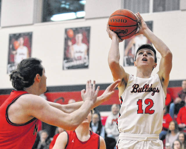 Josh Brown | Miami Valley Today Milton-Union's Nathan Brumbaugh scores in the paint Friday against Madison at Milton-Union High School.