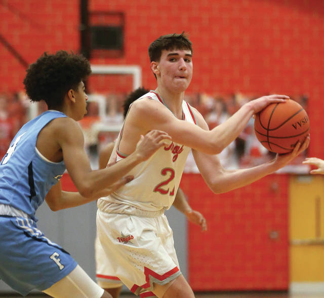 Lee Woolery | Miami Valley Today Troy's Landyn Henry protects the ball from a Fairborn defender Tuesday at the Trojan Activities Center.