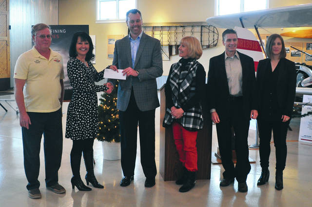 Provided photo At a ceremony Tuesday, Dec. 17, the donation was accepted by WACO Air Museum's Directors Gretchen Hawk and Nancy Royer, along with the WACO Board of Trustees. Cory May, vice president of Aftermarket for Landing Systems at Collins Aerospace, made the presentation.