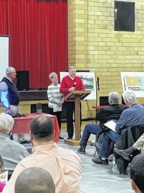 "Thom and Pat Robinson, on behalf of the board of directors of the Robinson Fund, announce the donation of a $1 million grant to Lincoln Community Center's Legacy Campaign during Wednesday evening's ""neighborhood meeting,"" at the center."