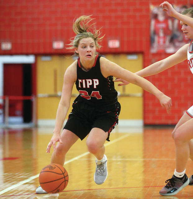 Lee Woolery | Miami Valley Today Tippecanoe's Kendall Clodfelter drives past a Troy defender Saturday at the Trojan Activities Center.