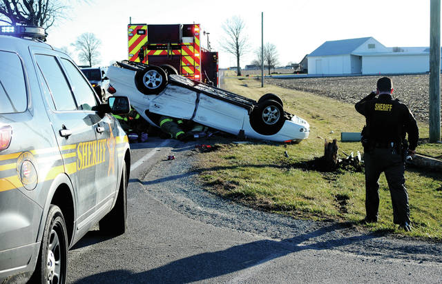 Troy firefighters and paramedics work to free a victim who was trapped in her vehicle following a crash on Nashville Road at Monroe-Concord Road on Sunday afternoon.