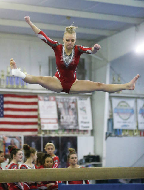 Lee Woolery | Miami Valley Today Troy senior Sarah Kraynek competes on the beam during Friday's Senior Night meet at Gem City Gymnastics.
