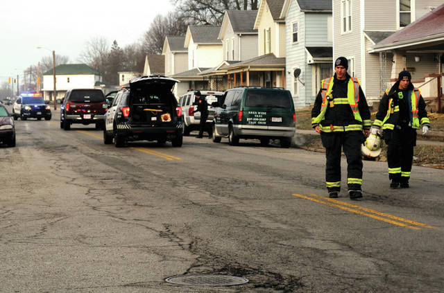Piqua police, firefighters, and medics work in the 800 block of South Street on Wednesday after a 12-year-old girl was struck by a vehicle after she ran into the path of the truck.