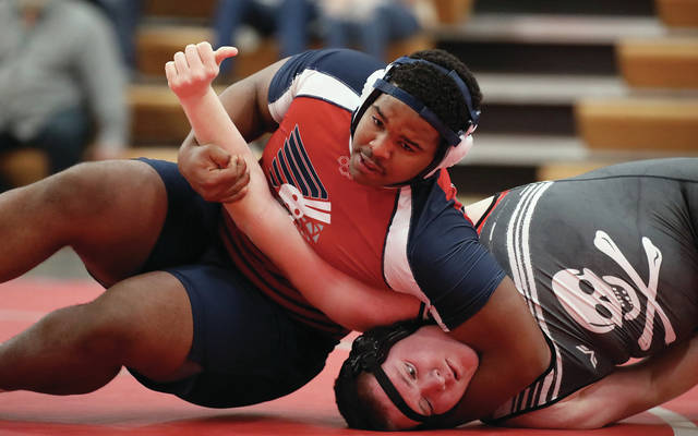 Lee Woolery | Miami Valley Today Piqua heavyweight Lance Reaves-Hicks works for a pin against West Carrollton during a quad Thursday night at Troy High School.