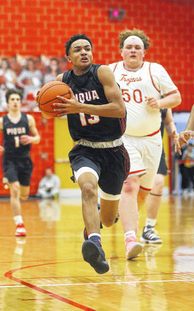 Lee Woolery | Miami Valley Today Piqua's Dresean Roberts goes to the basket on a fast break against Troy Friday at the Trojan Activities Center.