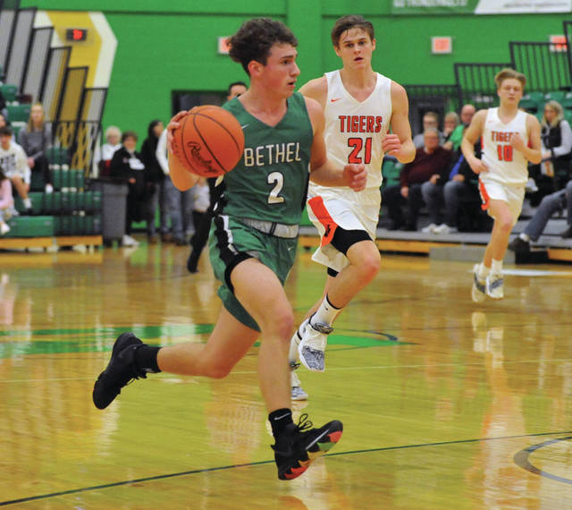 Josh Brown | Miami Valley Today Bethel's Cannon Dakin brings the ball up the floor after a steal during a Division III sectional tournament game against West Liberty-Salem Friday at Northmont High School.