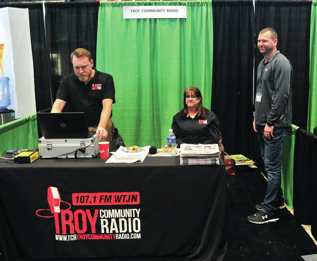 Scott Hornberger and Lori Burch of Troy Community Radio chat with Sean Ray at Hobart Arena on Friday afternoon as the Miami County Home and Garden Show gets under way. The event is sponsored by the Western Ohio Homebuilders Association and is open on Friday 2-7 p.m. Saturday10-7, and Sunday 10-4.