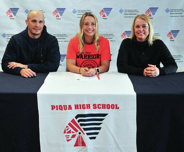 Mike Ullery|Miami Valley Today Piqua High School senior Tayler Grunkemeyer signed her letter of intent to play women's soccer for Indiana Tech. Shown with Grunkemeyer are her parents Kelly and Cher Grunkemeyer.