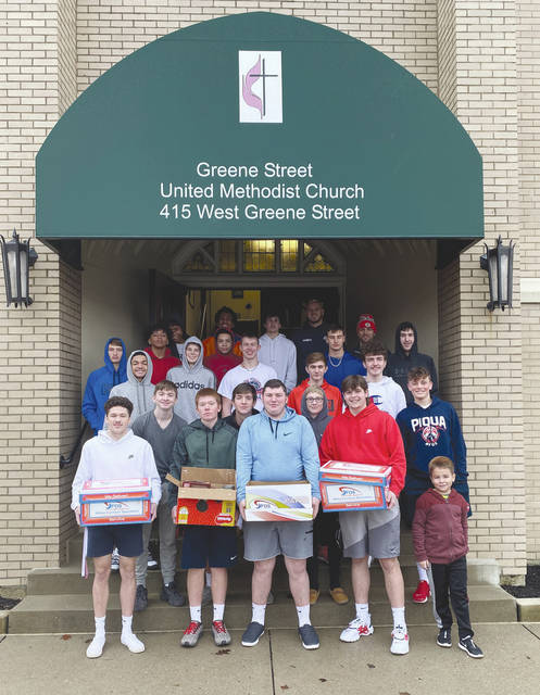 PIQUA — The Piqua High School Boys Basketball teams recently delivered boxes of canned food goods to the Greene Street United Methodist Church Food Pantry. The canned goods were collected during a boys basketball game earlier in the season.