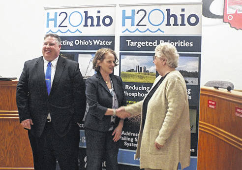 Matt Clevenger   For Miami Valley Today West Milton Mayor Anthony Miller, Ohio EPA Directo Laurie A. Stevenson and Ludlow Falls Mayor Patricia Neisley celebrate following an announcement where the Ohio EPA has awarded $500,000 from its H2Ohio fund for the installation of sewers in Ludlow Falls.