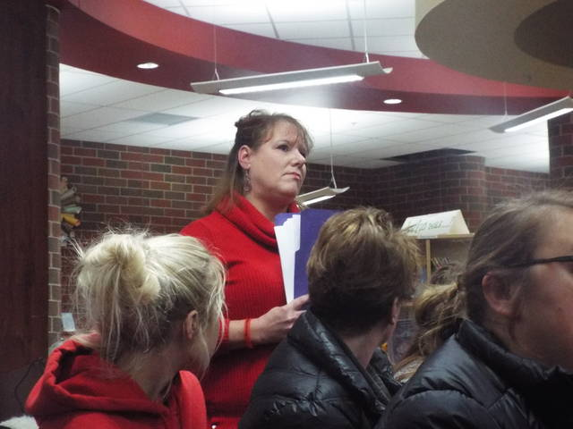 Parent Holly Taylor holds a folder of student comments regarding former guidance counselor Paula Shaw. Taylor presented the folder to the board prior to accepting Shaw's resignation.