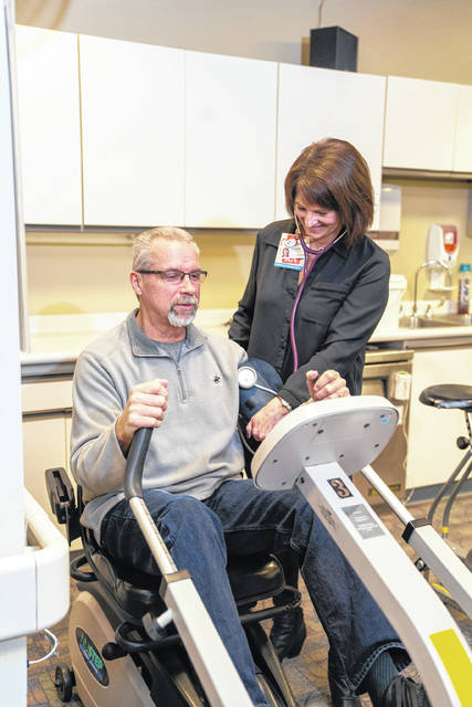 Provided photo Tami McMillan, right, works with Sam Silvers in the UVMC cardiac rehab program