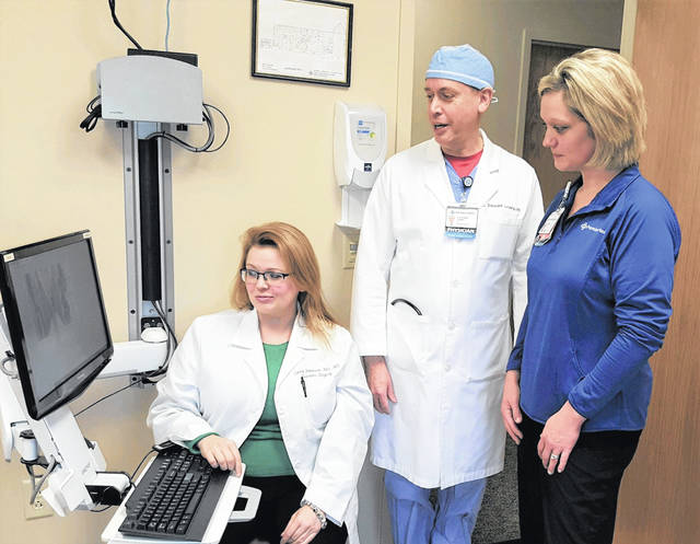 Dr. Laura Peterson and Dr. Stewart Lowry discuss aspects of the new endovenous laser ablation service with Sara Cleveland, R.N., VeinCare case manager at Upper Valley Medical Center.