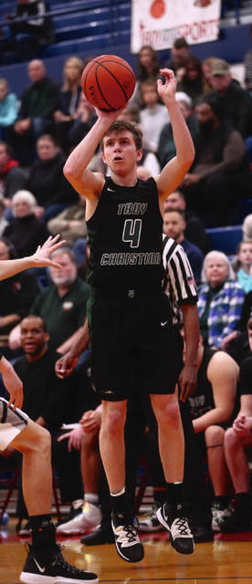 Lee Woolery|Miami Valley Today Troy Christian's Connor Peters shoots a 3-pointer Thursday night.