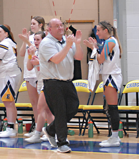 Rob Kiser|Miami Valley Today Edison State Community College women's basketball coach Tim McMahon claps out the final seconds of a 91-73 win over Lakeland Saturday that gave the Chargers a share of the OCCAC title.