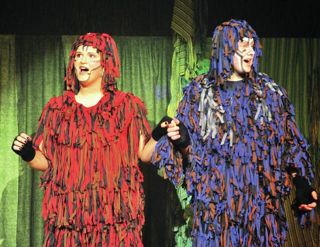 "Kari Marion, playing Kala, left, and Alex Rossman, playing Kerchak, perform during a dress rehearsal of the Piqua High School Music Department's production of ""Tarzan."""