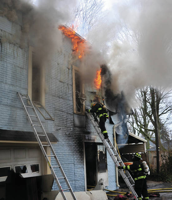 Firefighters from Piqua, Covington, and Fletcher battle a structure fire at 1516 Nicklin Ave. in Piqua on Saturday afternoon.