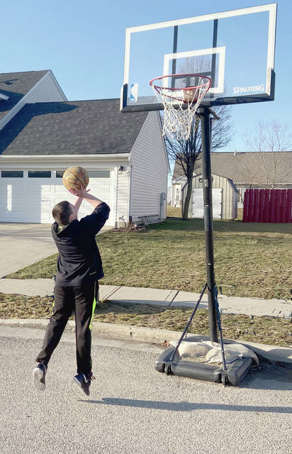 Melody Vallieu | Miami Valley Today With sunny skies over the last few days, children, including AJ Edwards of Piqua, are emerging from their homes to enjoy outside activities. He is the son of Brian and Jessica Edwards.