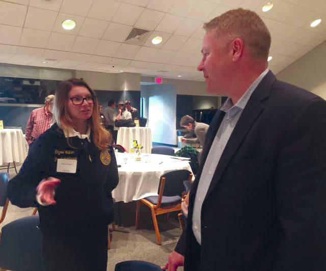 Congressman Warren Davidson visits with Olyvia Walker, 16, of Troy, at the annual Farm Forum held at Edison State Community College on Saturday. Walker is a student at Upper Valley Career Center studying landscape design and is a member of the FFA.