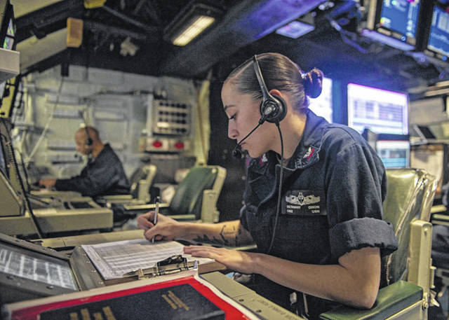 U.S. Navy photo by Mass Communication Specialist Seaman Apprentice Theodore C. Lee Operations Specialist 2nd Class Bethany Dixon, from Troy, , assigned to Tactical Air Control Squadron 12, stands watch in the tactical air control center of amphibious assault ship USS America (LHA 6) in support of Cobra Gold 20, on March 4. America Expeditionary Group-31st Marine Expeditionary Unit is participating in CG 20, the largest theater security cooperation exercise in the Indo-Pacific Region and an integral part of the U.S. commitment to strengthen engagement in the region.
