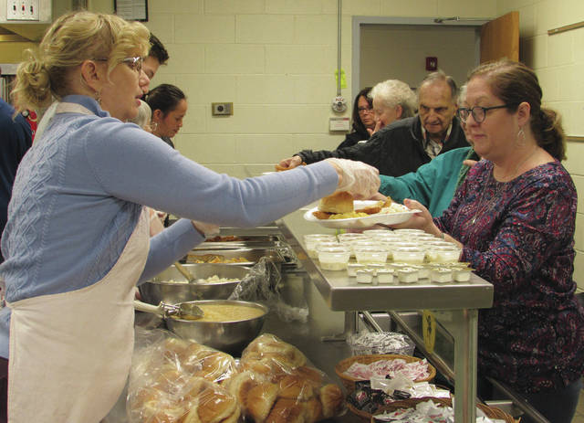 With return of the season of Lent also came St. Mary Catholic Church's 35-plus year tradition of Friday fish fries. Eden Merrifield (front left) works alongside other members of St. Mary Catholic Church, including Sister Mary Alice, Donovan O'Leary, Rosie O'Leary, and more to serve up the church's Lent fish fry meals inside Piqua Catholic School's cafeteria on Friday evening. Mitch Hohlbein (not pictured) has organized the event for over the last 20 years. St. Mary Catholic Church, 503 W. North St., inside Piqua Catholic School, Piqua, will continue its Lenten fish fries from 5-7 p.m. on Fridays through April 3. Prices are $9 for adults, $7 for seniors (55 and over); $6 for children 12 and under. Carry-outs available for $8. The school is handicapped accessible.