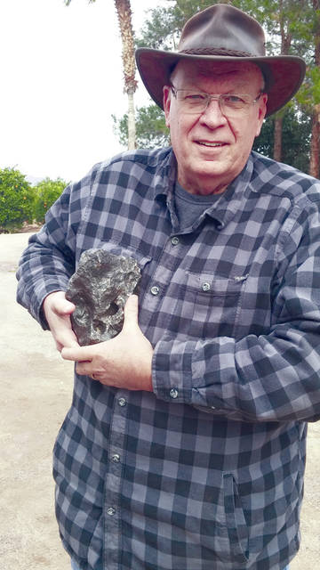 Provided photo Jerry Stark shows off a 20-pound meteorite he found in an Arizona canyon. He plans to return to pursuing hobbies that include paleontology following prostate cancer surgery.