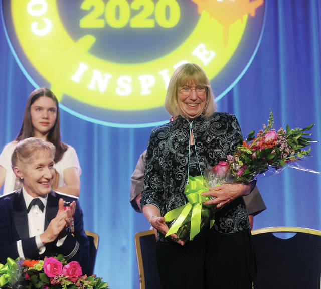 Miami County resident Patty Wagner receives an ovation during her induction in to the Women in Aviation International Pioneers Hall of Fame Class of 2020 during last weeks conference in Orlando, Fl