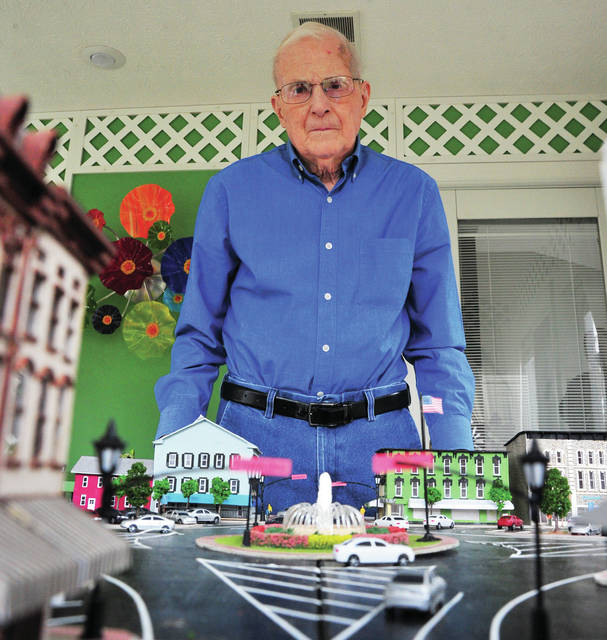 Gail Stickelman of Tipp City displays his recently completed 1/8-inch scale model of the Troy Public Square that he built as his latest 3D model. The 86 year old intends to donate the artwork.