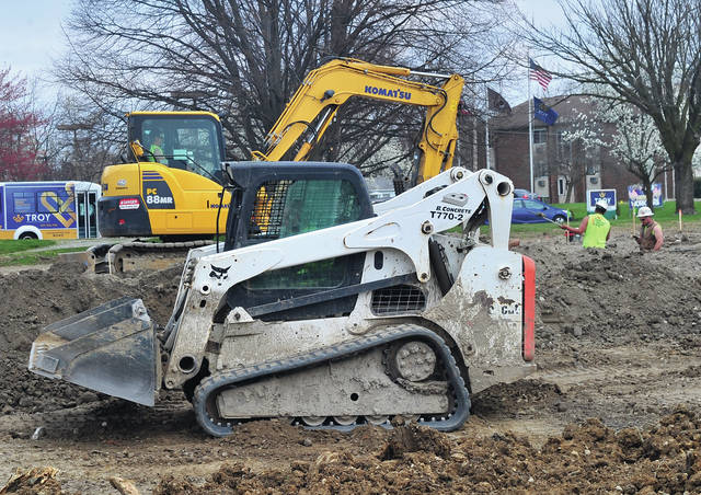 Construction crews work at the site of the new Family Abuse Shelter of Miami County on Crescent Drive in Troy during the past week.