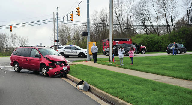 Troy Fire Department medics, firefighters, and Troy police work at the scene of a multi-vehicle crash at South Dorset and Arthur Drive on Wednesday afternoon. At least three injuries were reported although none were thought to be serious.