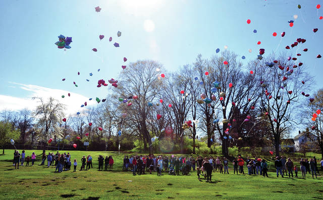 Hundreds of balloons float into the sky at Lower Mote Park on Monday afternoon in tribute to 2017 Piqua High School graduate Darby Wright who passed away over the weekend. Wright was employed by UPS and the City of Piqua. The event drew a number of Wright's classmates, show choir alumni, friends, and family to honor a young man who was taken too soon.