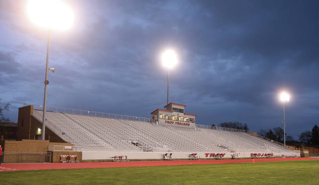 "Lee Woolery | Miami Valley Today The lights shine at Troy Memorial Stadium Monday night as Troy High School takes part in the ""Be the Light"" campaign to honor the class of 2020."