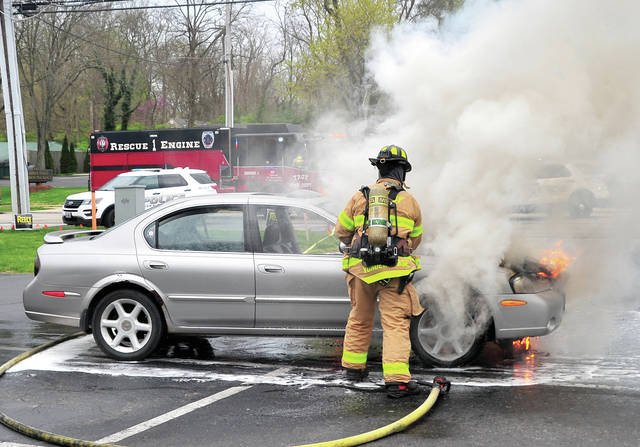 Troy firefighters battle a car fire in the parking lot of La Fiesta Express on West Main Street on Saturday around 5:30 p.m. A woman was in the drive-thru line when her vehicle began to smoke. As she moved forward she began to see flames so she moved to the parking lot and got out of the car. Troy Fire Department and police responded. The fire was extinguished. There were no injuries.