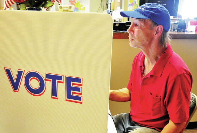 Troy resident Timothy Feltner casts his ballot at the Miami County Board of Elections Office on Tuesday afternoon, the last day to vote in this 2020 Ohio Primary Election.