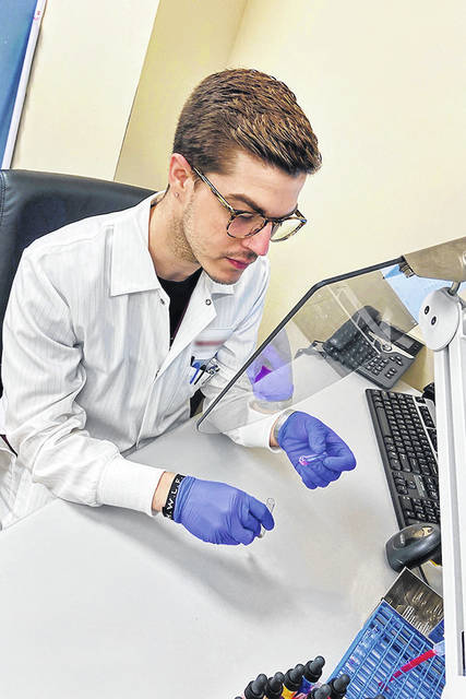 Taylor Kolker performs work as a medical laboratory technician in blood transfusion services at Miami Valley Hospital.