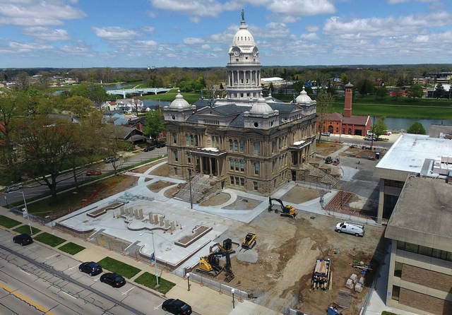Construction crews have been working on the redesigned plaza at the Miami County Courthouse in recent weeks, including installing the new fountain design that utilizes stones from the county's old jail from the 1800s. Outdoor Enterprise of Casstown is working on the current phase, which includes the construction of new design of the plaza. The cost of the current phase of this project is approximately $2,948,000.